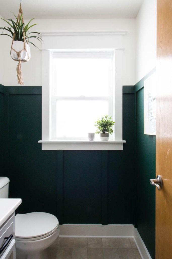 white-window-trim-in-green-bathroom