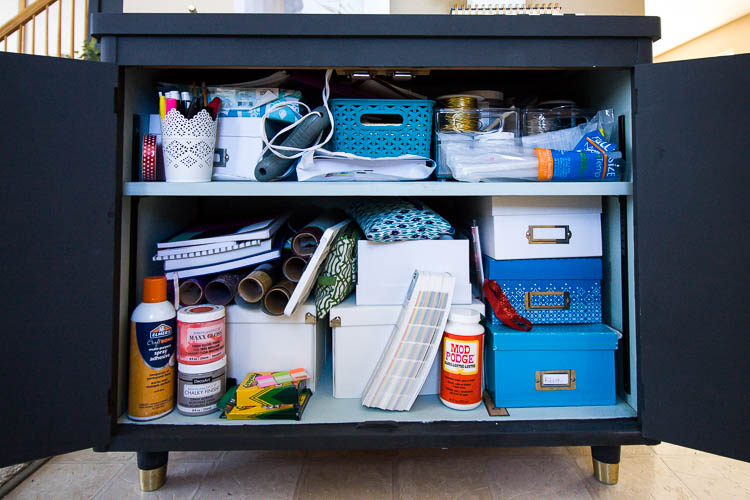 messy-craft-supplies-in-cabinet