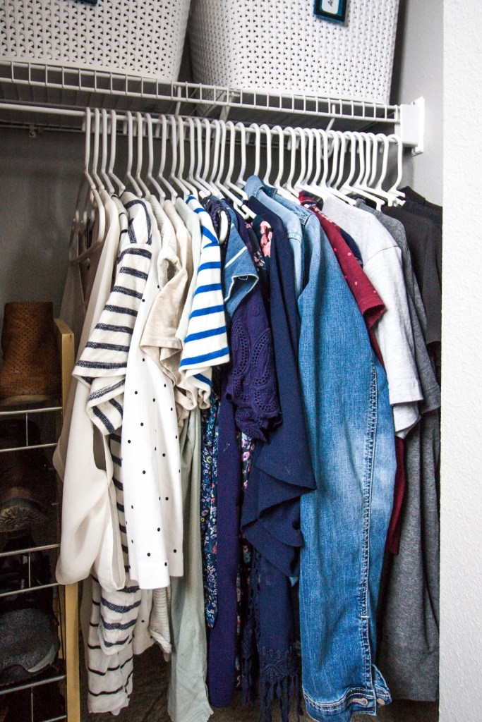 color-coded-clothes-hanging-in-closet
