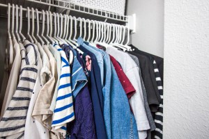 color-coded-shirts-hanging-in-organized-closet