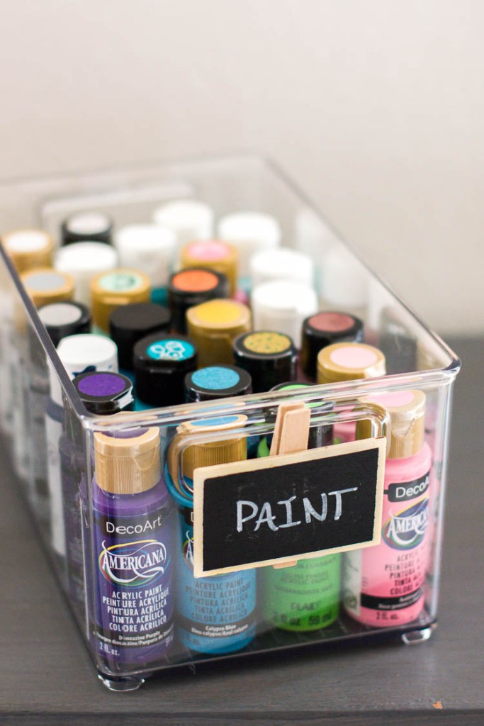 chalkboard-label-clothespin-clipped-onto-clear-container-of-craft-paint