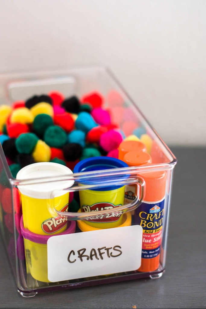 whiteboard-label-on-clear-bin-of-colorful-pompoms