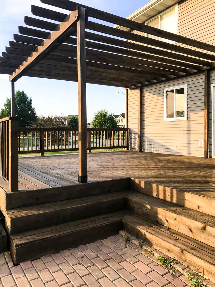 deck-with-pergola-being-stained