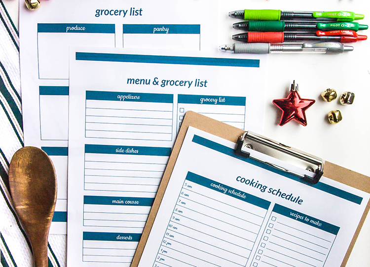 christmas-meal-planner-and-grocery-list-printables-on-table