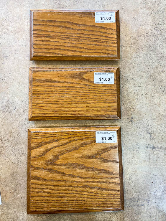 3 oak cabinet drawer fronts on table