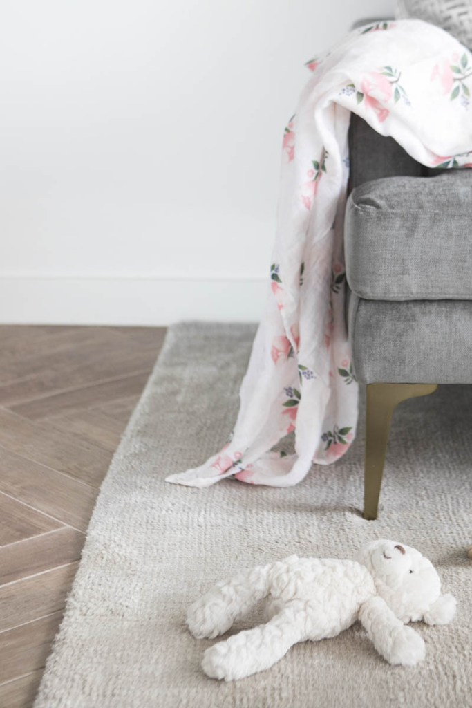 gray couch with toys on floor