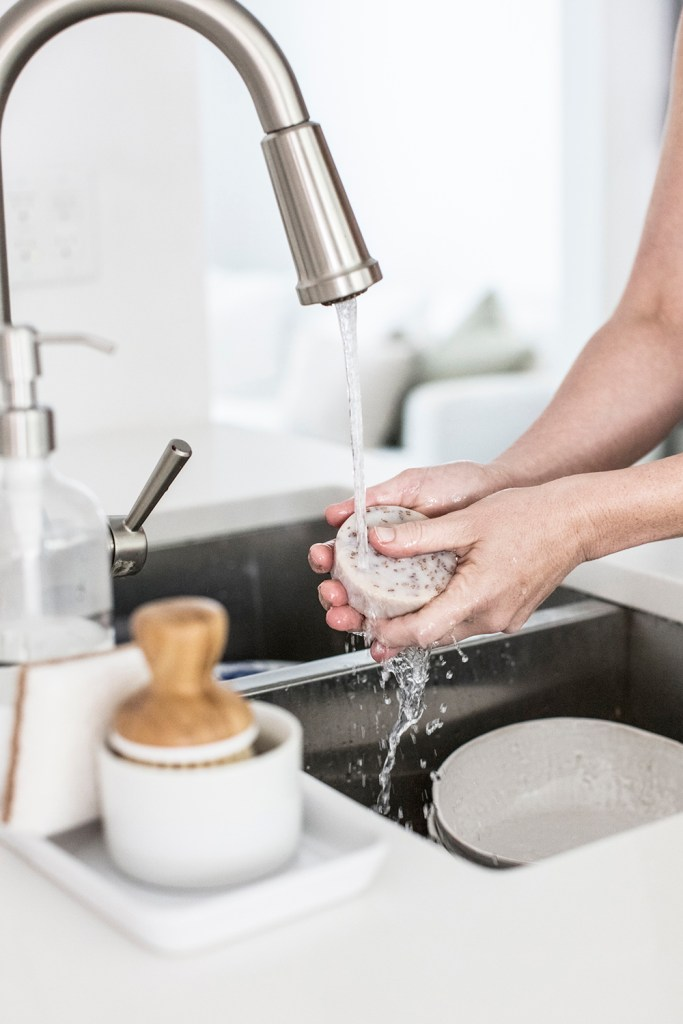 hands-washing-dishes-in-sink