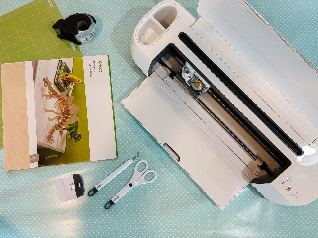 cricut maker and basswood on table