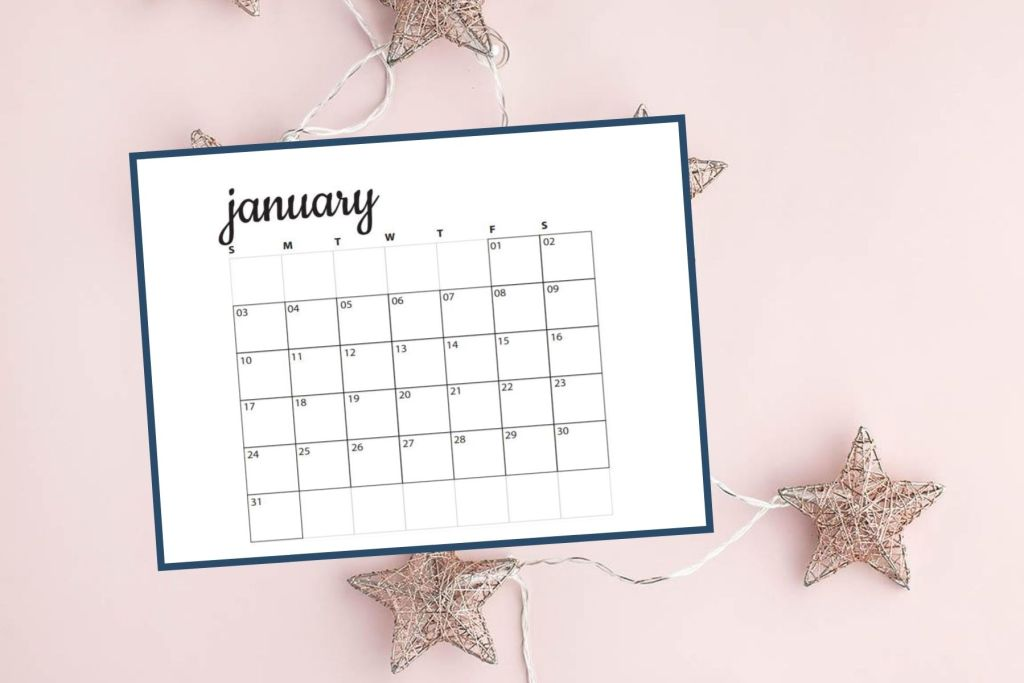 image of january calendar over star string lights