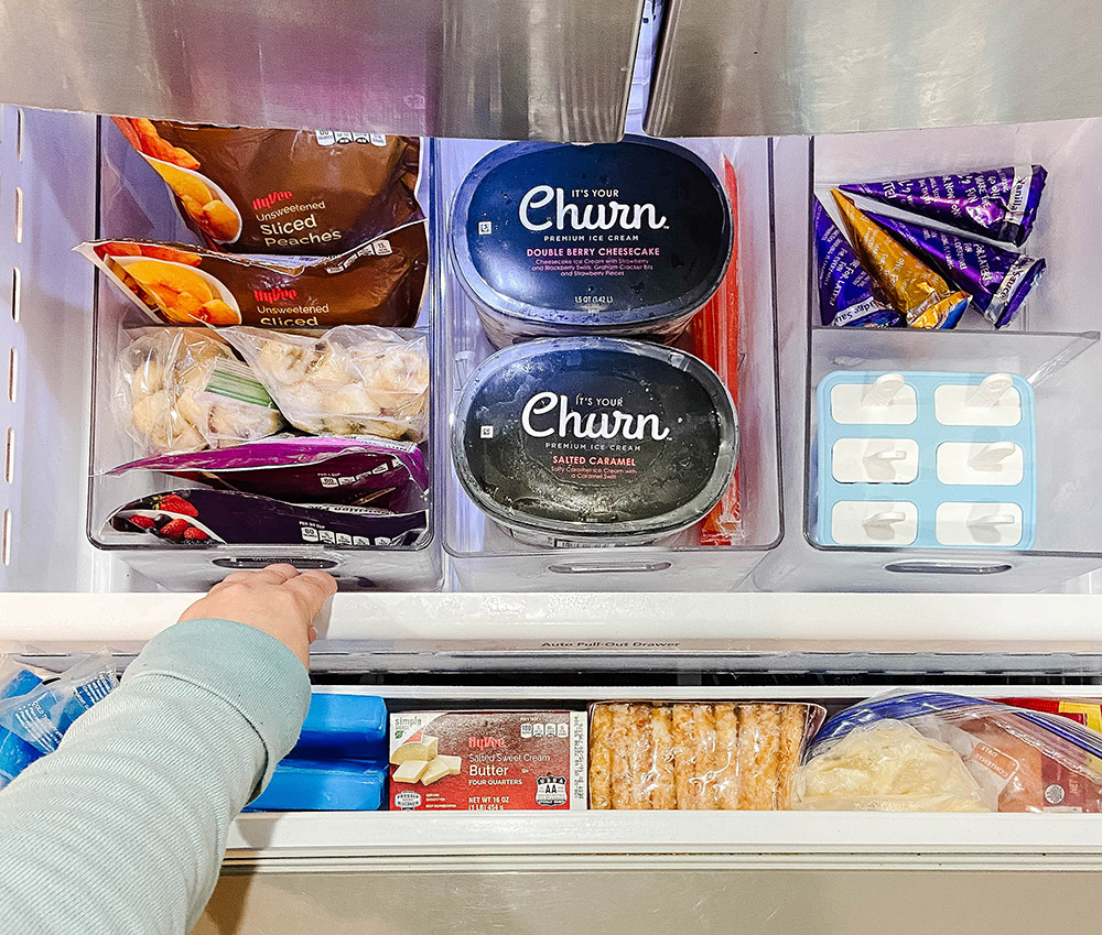 freezer drawer of food with text