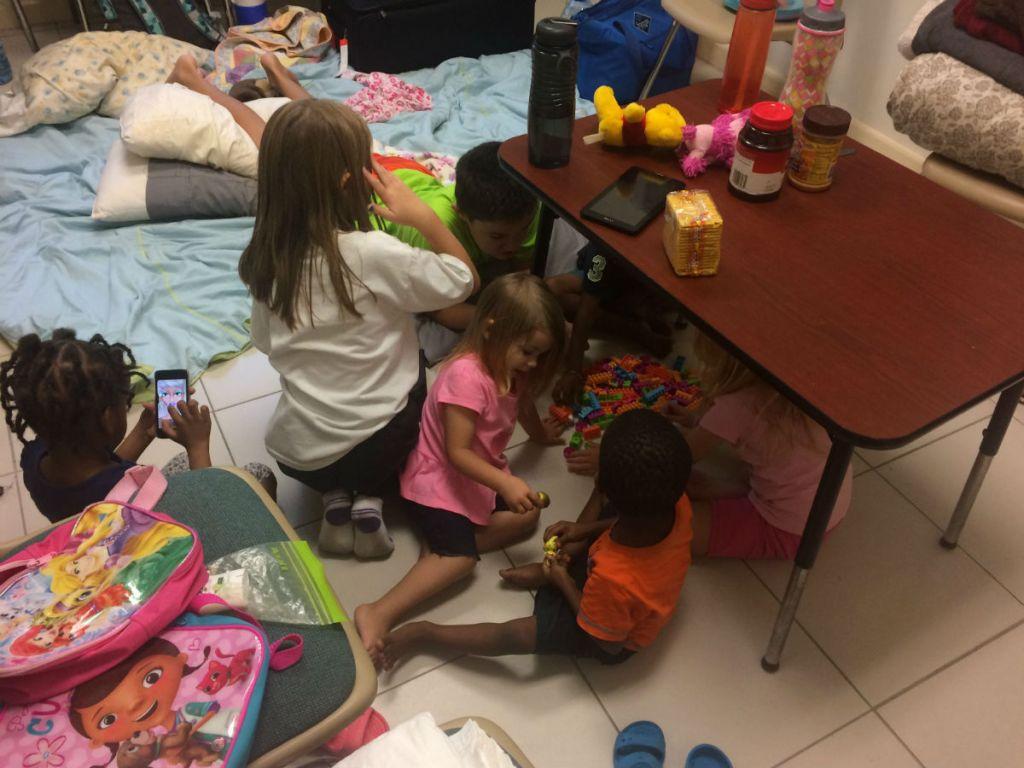 children playing games during the beginning of hurricane irma