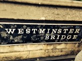 Wall sign on the Westminster Bridge