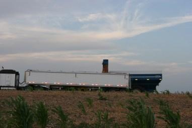 tractor filling semi