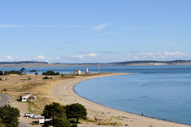 The beach and Point Wilson Lighthouse at Fort Worden.