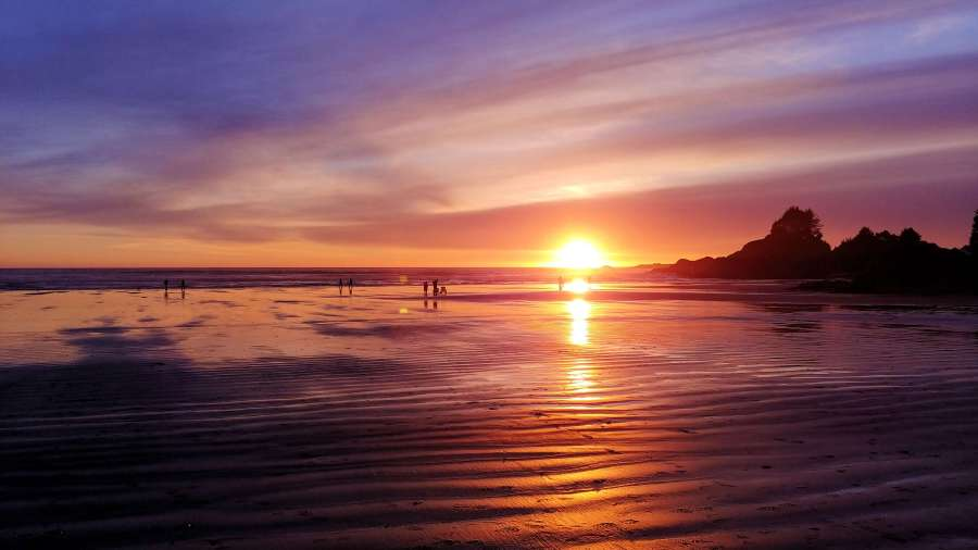 Sunset at Cox Bay Beach in Tofino, British Columbia.