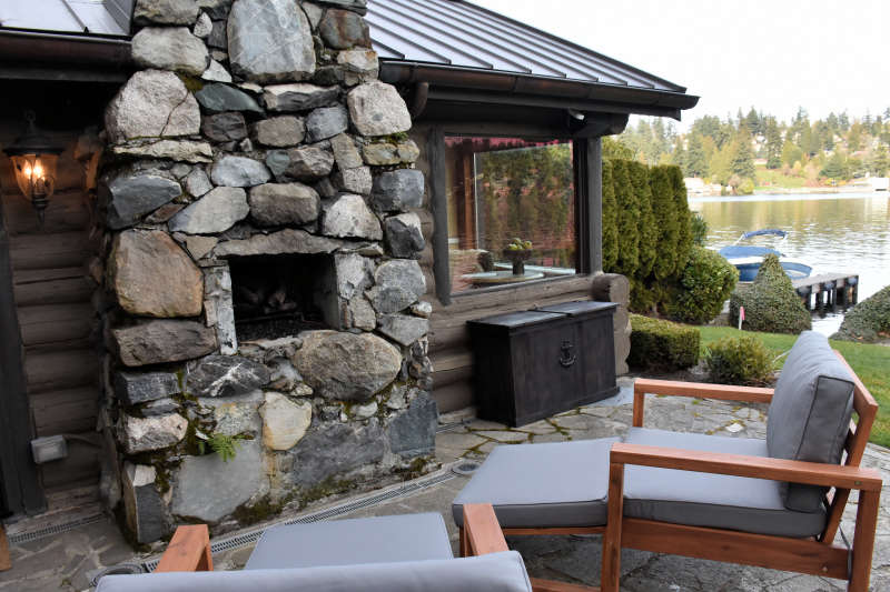 The outdoor patio at the lakeside cabin near Seattle in Medina, Washington.
