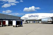 Lufthansa plane and luggage containers