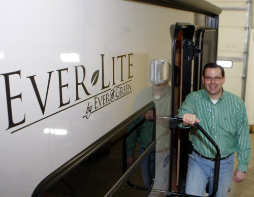 Tribune Photo/GREG SWIERCZ The Ever-Lite line of RVs features environmentally conscious materials and is offered by EverGreen RV of Middlebury. Standing at the door is Douglas M. Lantz, president and chief operations officer of Evergreen RV.
