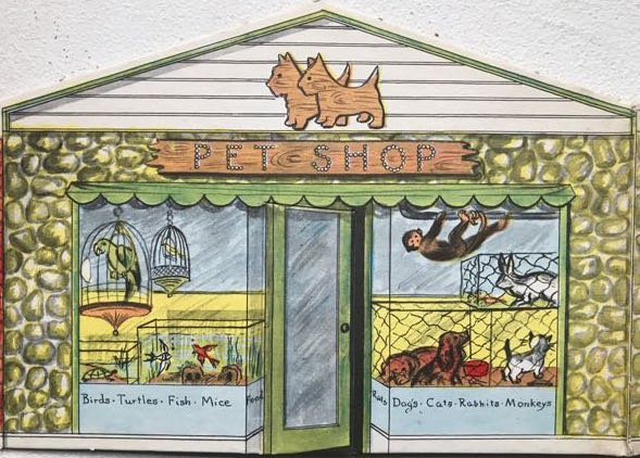 cardboard cut-out illustrating entrance to and shop windows of a fictional pet shop.