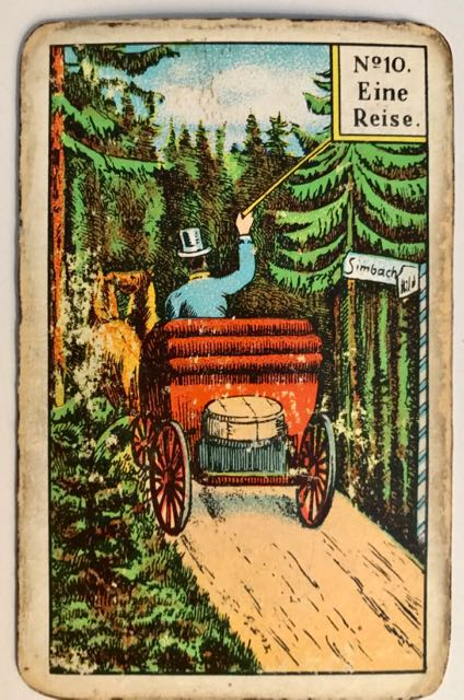Kipper card no 10 - A journey. Drawing of a horse-driven carriage going through a forest road.