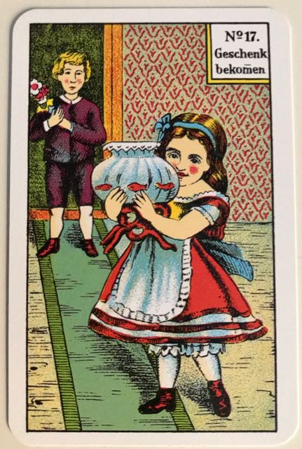 Kipper card - receiving a present. Small girl holding a goldfish bowl while a boy looks on.