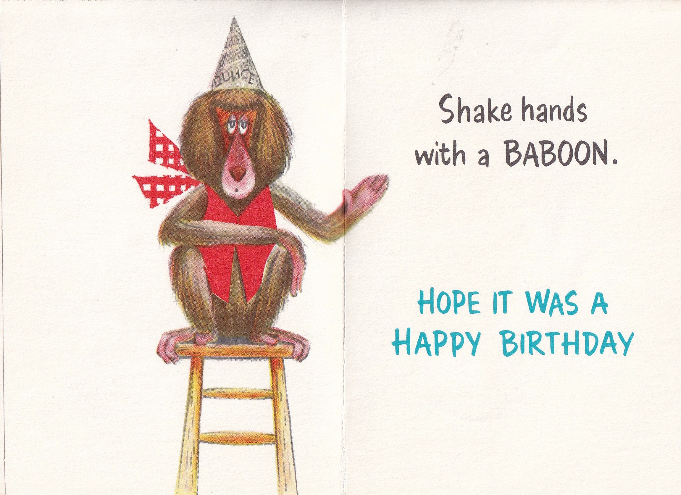 inside vintage greeting card - drawing of a baboon wearing a Dunce hat