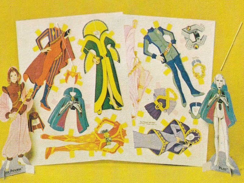 Details of content of paper doll book; Space background, doll's paper clothes, interior of spaceship