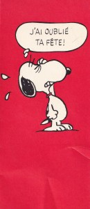 vintage card showing Snoopy the dog on red background - text bubble says I forgot your birthday (in French)