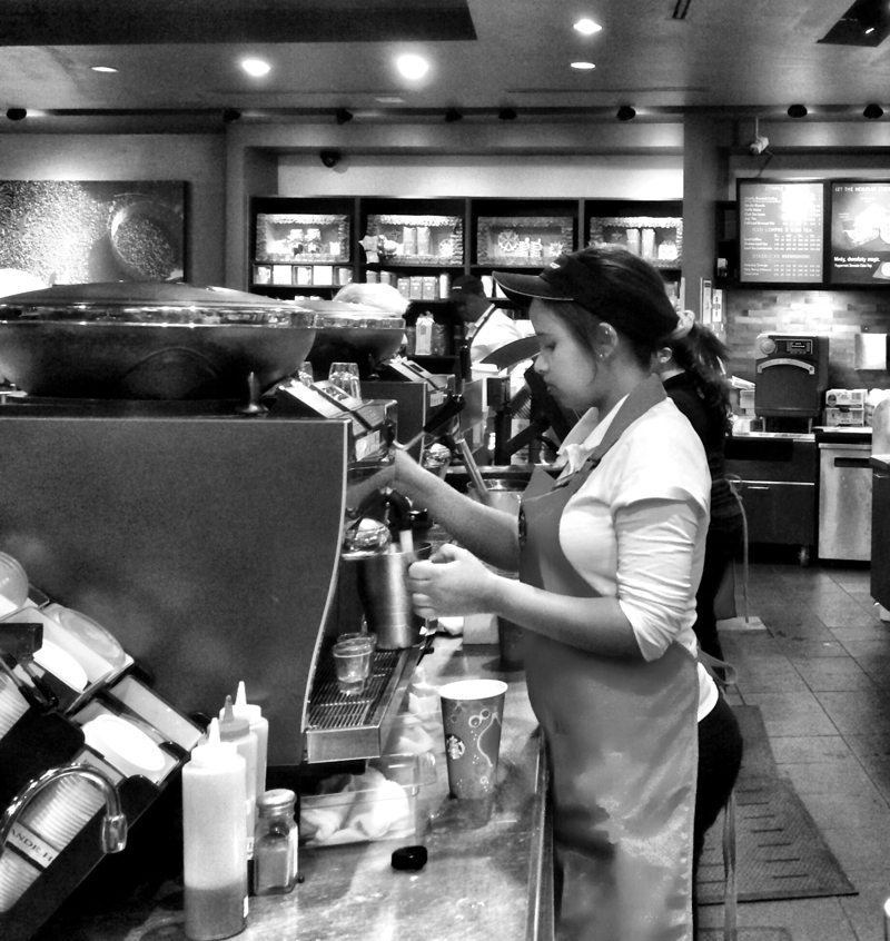 Starbucks barista make a coffee in Bethesda, Maryland