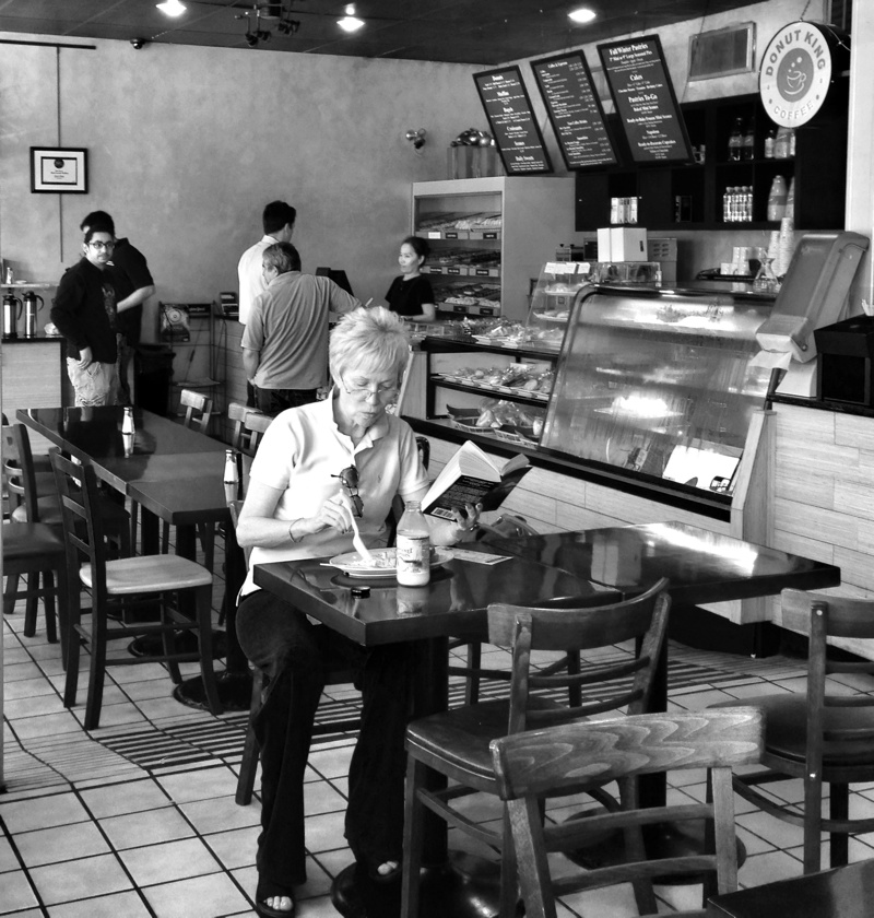 Woman eating breakfast at the Donut King in Kensington, Maryland