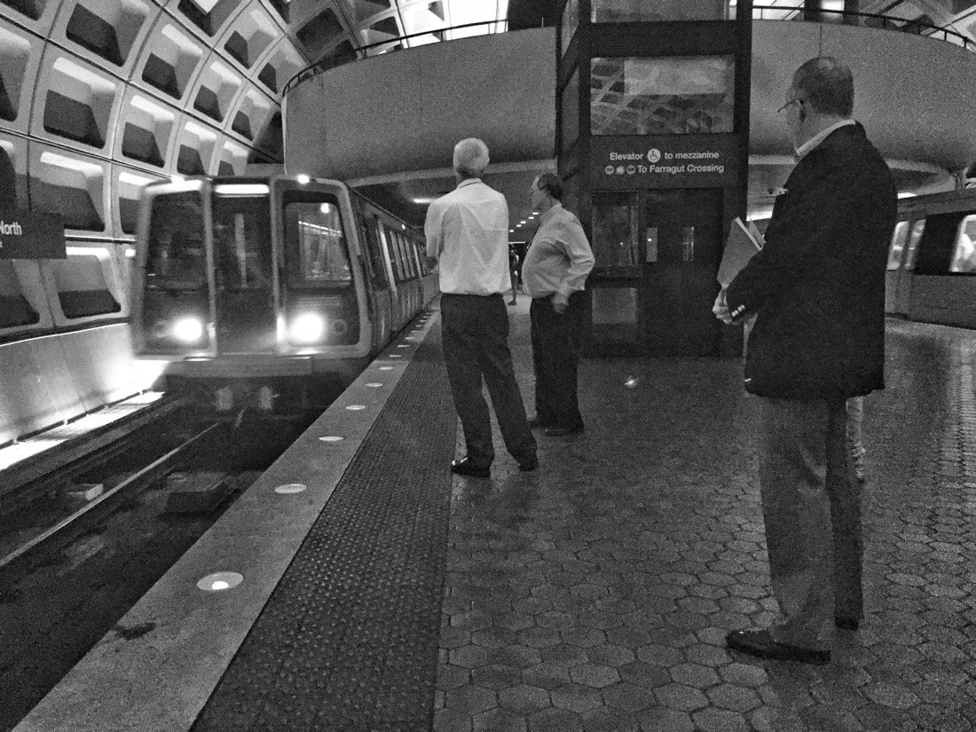 Waiting for the Metro train at Farragut North station in Washington DC
