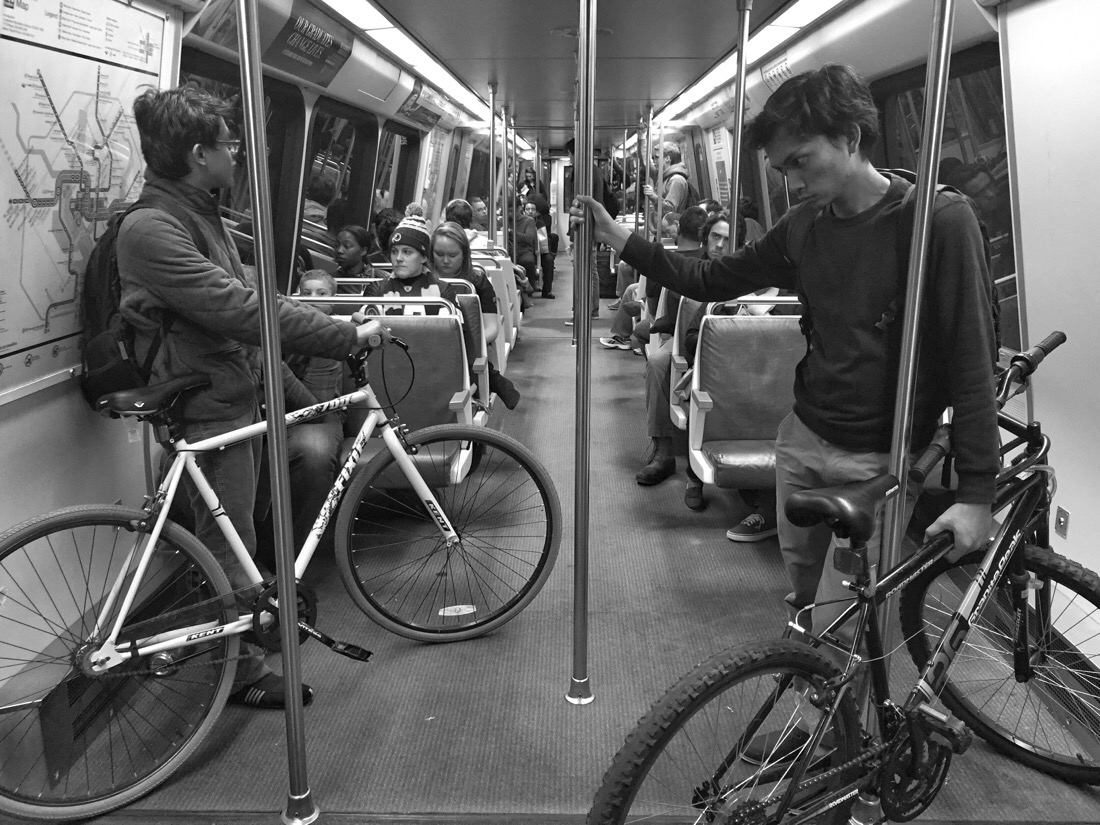 two bicyclists on a metro car in washington dc