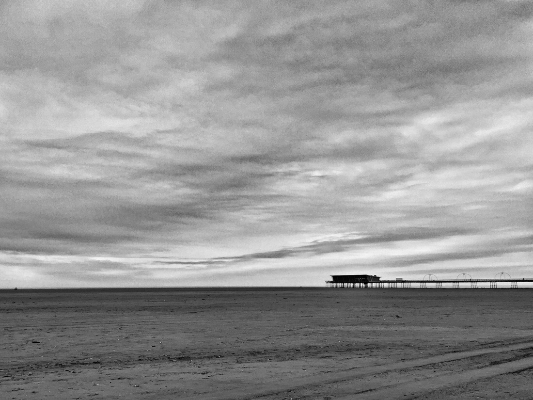 Looking across southport beach towards southport pier with the tide out
