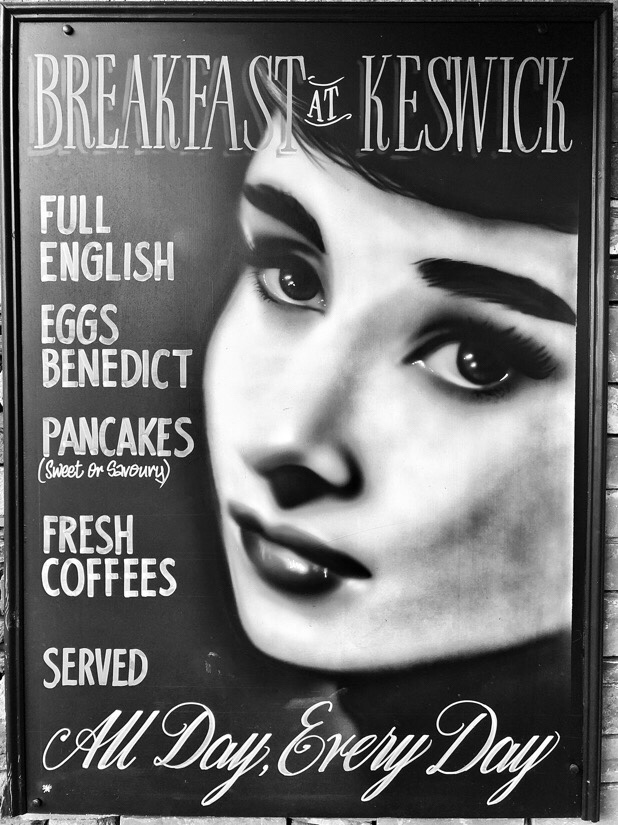 Advertising sign for the filling station cafe in Keswick, uk