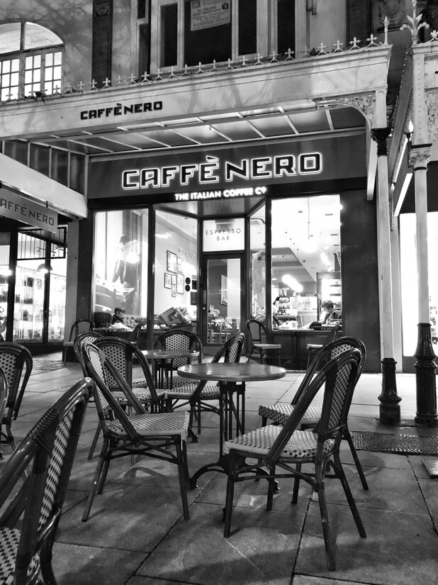 People enjoying an evening coffee at Nero coffee shop in Southport.