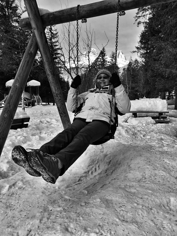 The Reluctant Model on the swings in Canazei, Italy.
