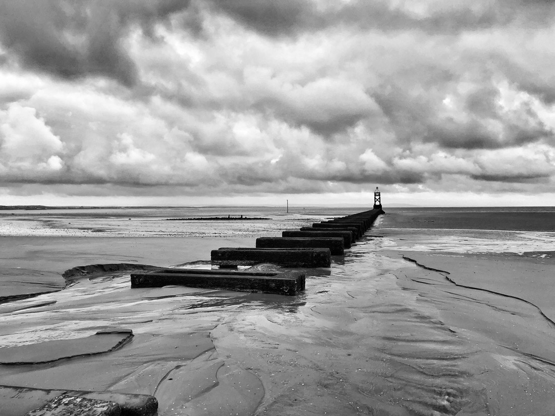 An overcast Saturday morning walking on Crosby Beach in Liverpool