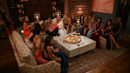 A large group of contestants sit on three sofas