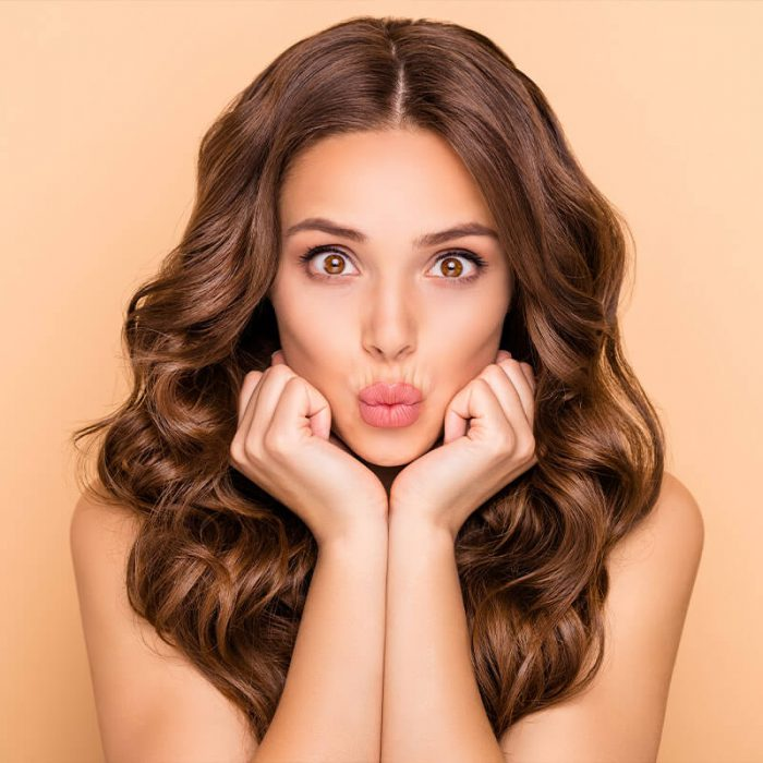 women with wavy hair and lips