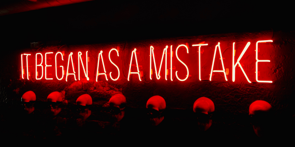 Neon sign about mistakes