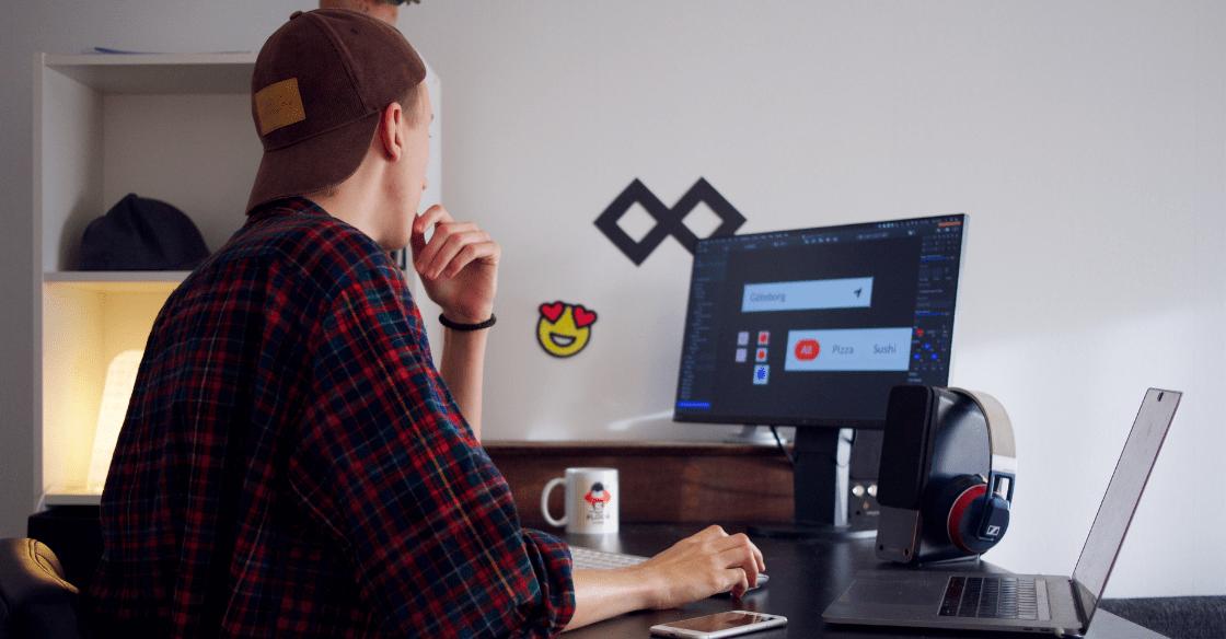Digital marketing contractor working at desk