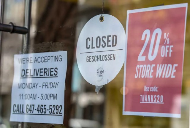 A closed sign on a Toronto store shut down by COVID lockdowns. Nearly six in 10 businesses also said they were using the federal government's interest-free loan program, the Canada Emergency Business Account (CEBA).