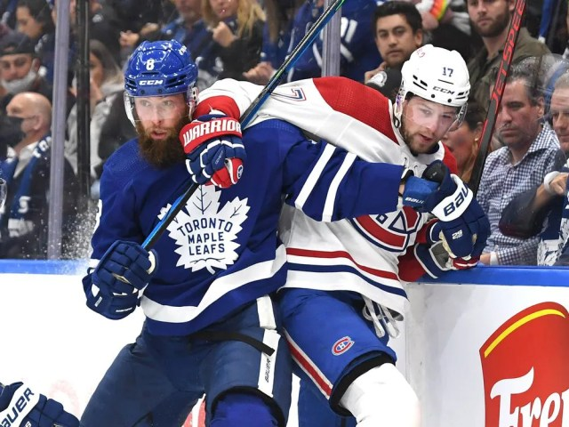Canadiens forward Josh Anderson battles along the boards with Leafs defenseman Jake Muzzin during first period at Scotiabank Arena Wednesday night.