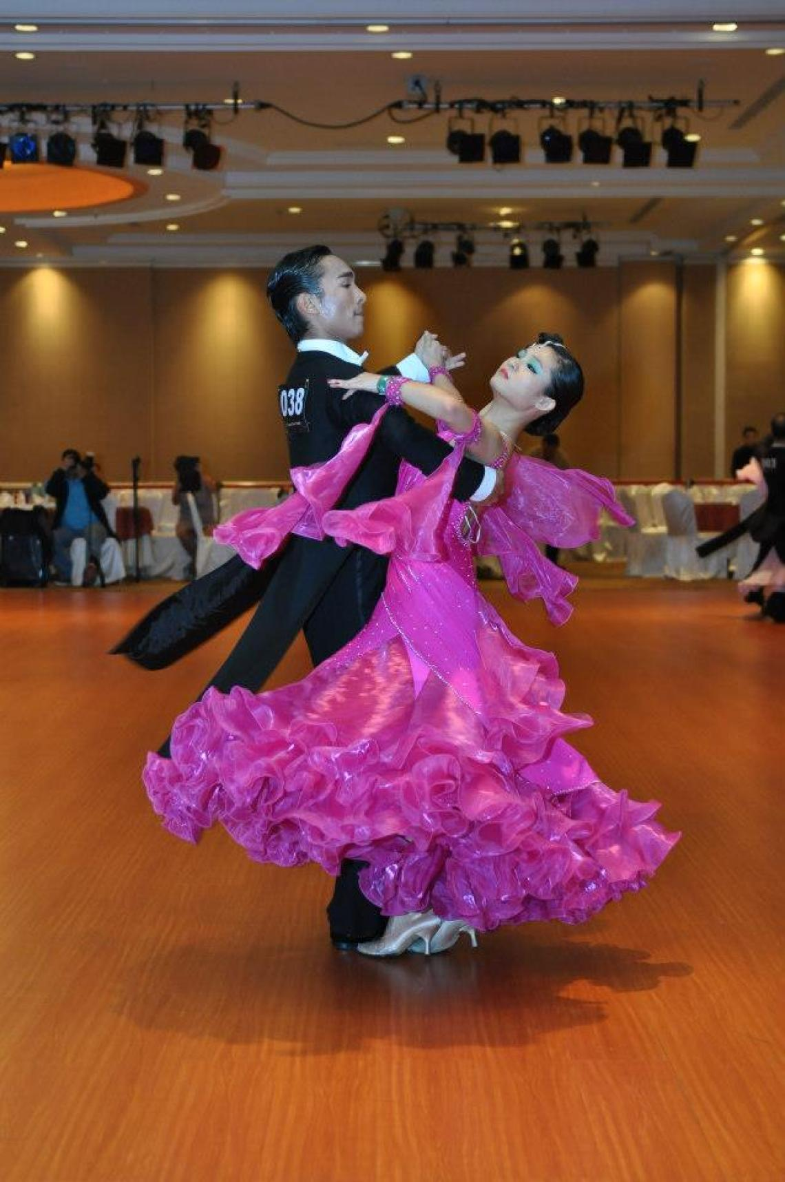 Man and woman dancing ballroom in a competition
