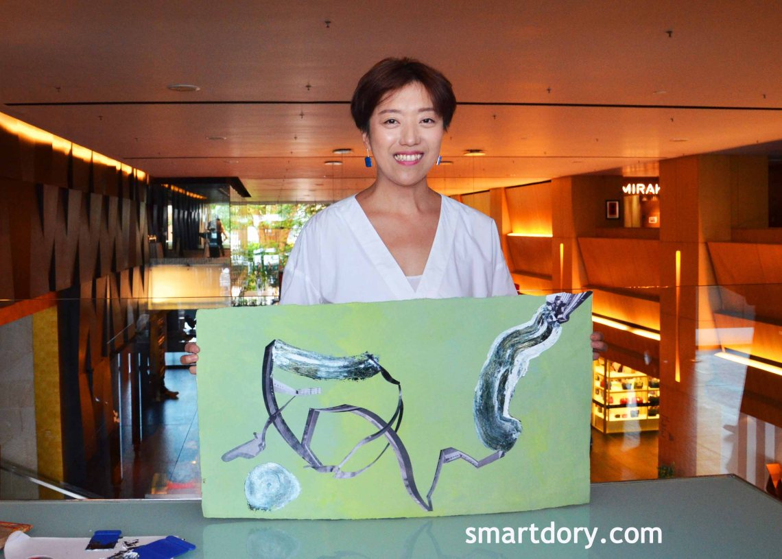Woman artist identified as Hong Kong based Lio Cheung with her finised painting at G Hotel Gurney, Penang