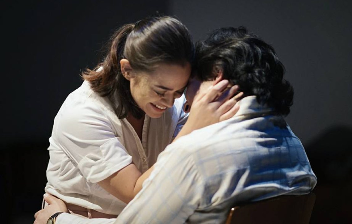 "Actress Steffanie Van Driesen holds actor Razif Hashim's face as she confesses her love in the play ""Betrayal"" written Harold Pinter and staged at penangpac, straits quay, georgetown, penang"