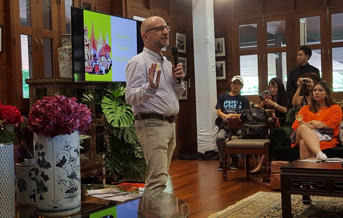 Photo shows a man holding a microphone and speaking to a group of seated women at the Nai Lert Park Heritage Home, Bangkok. The man is identified as French researcher and author Luc Citrinot, Photo taken by Doris Lim