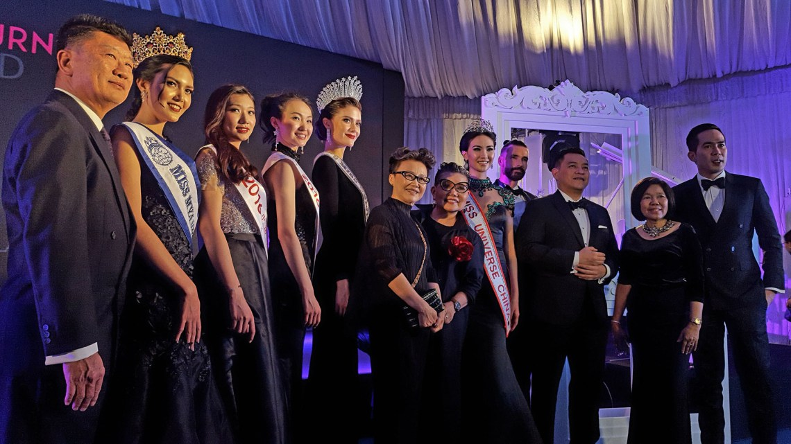 Photos shows a total of 12 people wearing suits and evening gowns with woman in centre identified as TAT Deputy Governor for International Marketing – Asia and the South Pacific, Mrs. Srisuda Wanapinyosak at the opening ceremony of the Women's Journey Thailand campaign 2017 on 1 August, 2017, at Nai Lert Park Heritage Home in Bangkok.