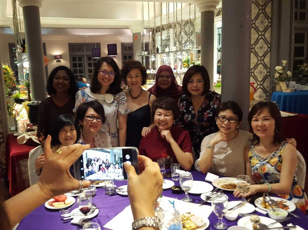 CLS Girls Celebrate Friendship Forged Over the Years_CLS 1980 girls taking photos with smartphones