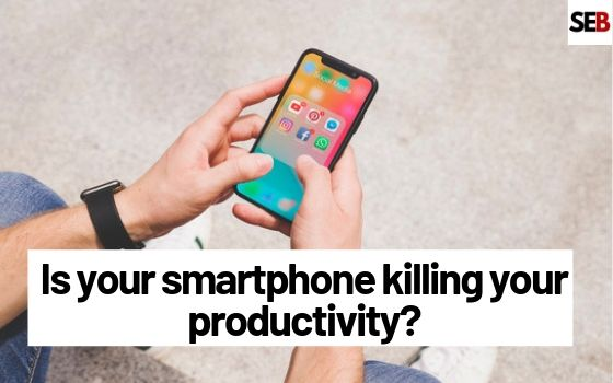 two hands pressing phone - is your smartphone killing you